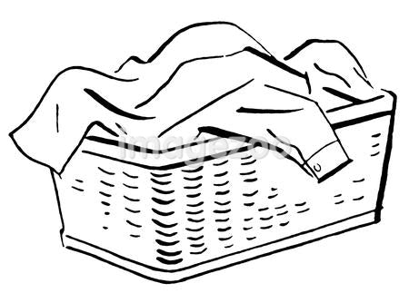 A black and white version of a basket full of laundry