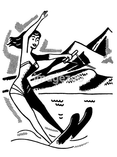 A black and white version of a vintage image of a woman water skiing