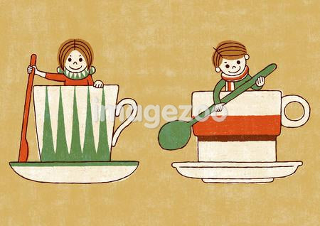 Two children playing in larger tea cups