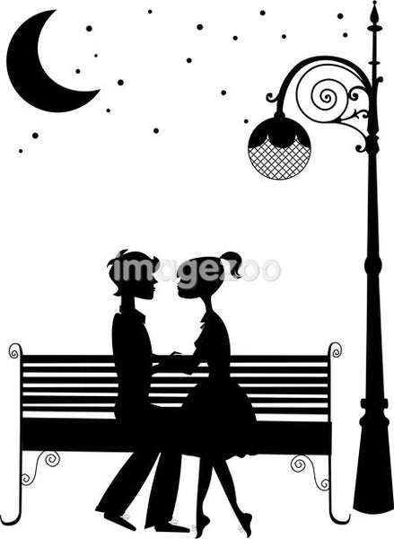 Silhouette of a couple sitting on a bench under the moon,holding hands