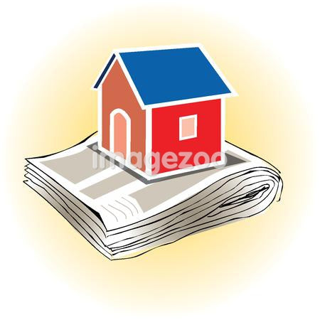 A house sitting on a pile of newspaper