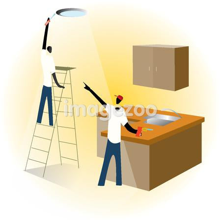 Two men installing lights and kitchen cabinets