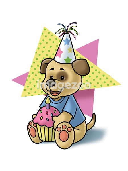 A puppy wearing a birthday party hat and holding a cupcake