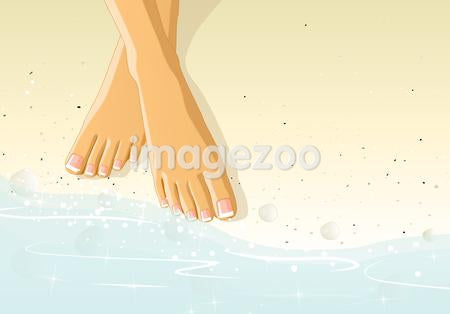 A woman's feet in the sand by water