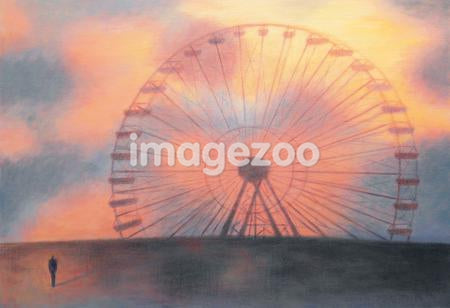 A man standing in front of a large ferris wheel