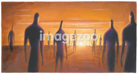 People walking towards the sun in the desert
