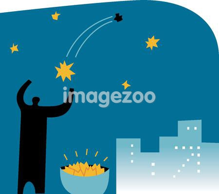 Silhouette of a man collecting falling stars