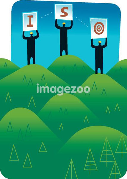 Silhouette of three men standing on green hills and holding letters ISO to illustrate standardized forestry