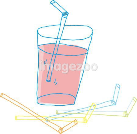 A glass of juice surrounded by straws.