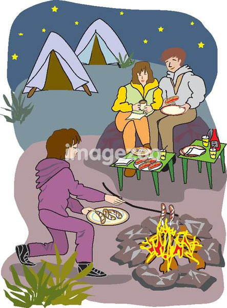 A family enjoying dinner by the campfire