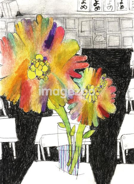 Flowers in a vase on a desk