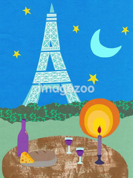 The Eiffel Tower with a romantic table setting in the foreground