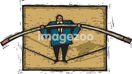 A businessman walking on a tightrope