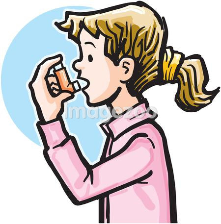 A girl using an asthma inhaler