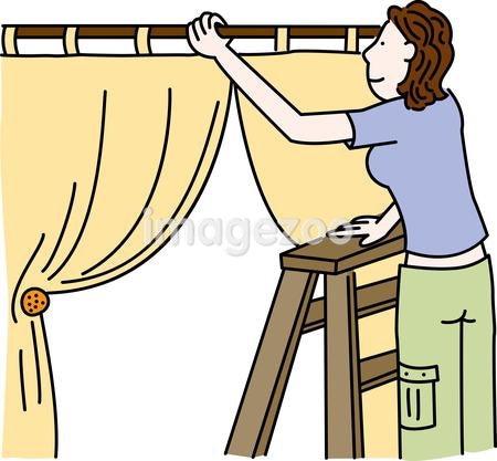 A woman on a ladder installing curtains