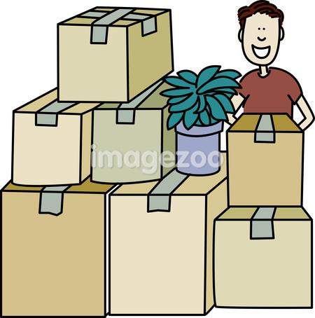 A man standing behind a stack of packed boxes