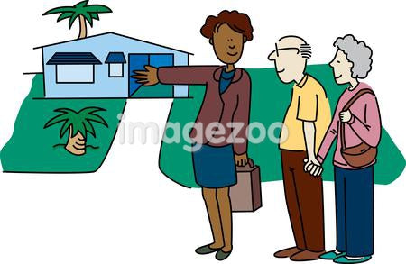A real estate agent showing a house to an elderly couple