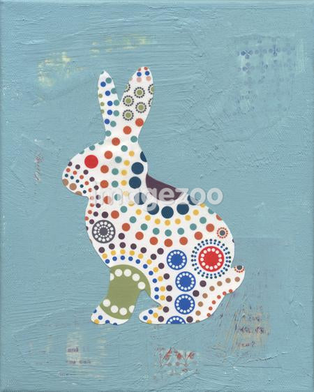 A collage of a rabbit with a colorful circle pattern