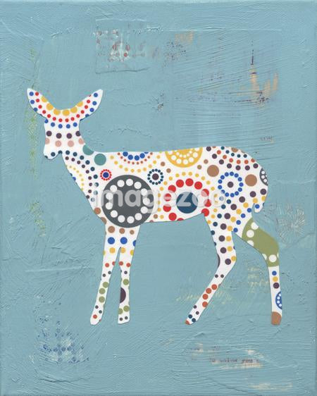 A collage of a deer with a colorful circle pattern
