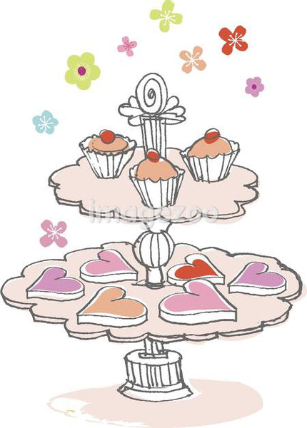 a cake stand with cupcakes and heart-shaped cookies
