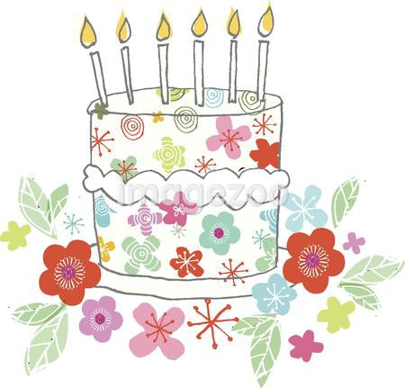 a flower-themed birthday cake with candles surrounded by flowers
