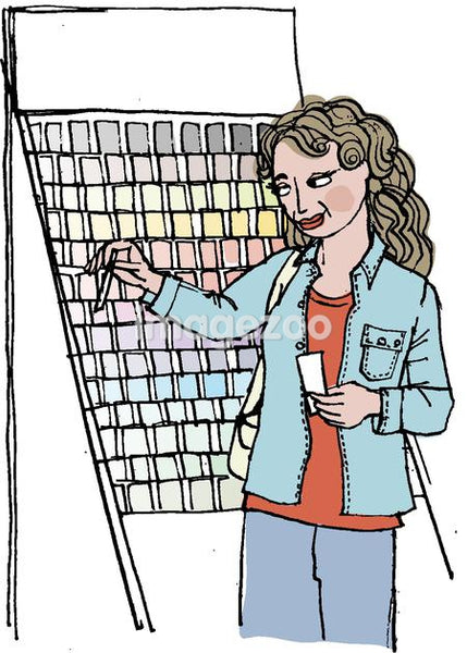 A woman choosing paint chips