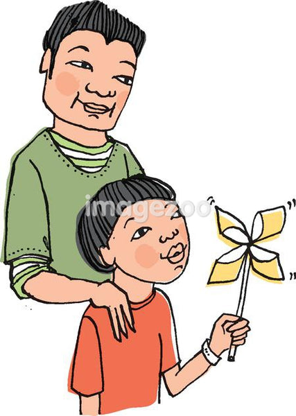 Father with his son blowing a pinwheel