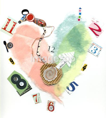 A paper collage of a heart-shaped clock