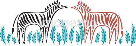Two different colored zebras