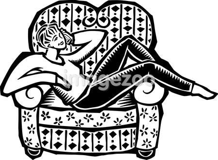 A woman talking on a cordless phone in an armchair