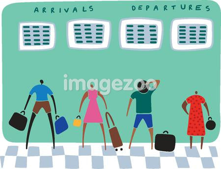 Travelers with their luggage looking at arrivals and departure boards