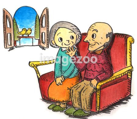 An elderly couple talking on the sofa