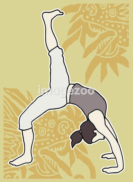 A woman practicing yoga in the Urdhva Dhanurasana pose