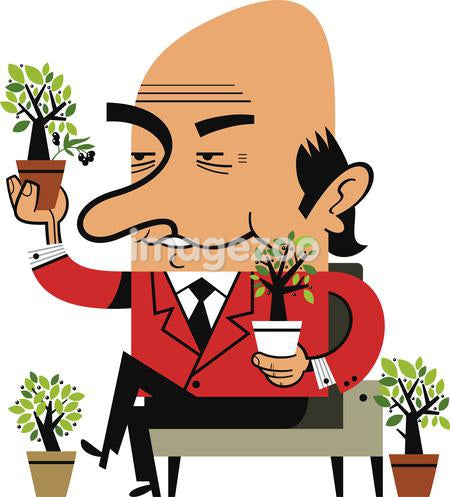 A businessman holding potted plants