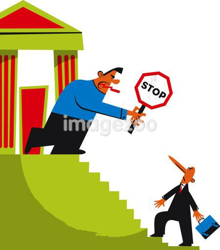 A man at the top of the stairs holding a stop sign in front of a bank, trying to prevent a man from coming up