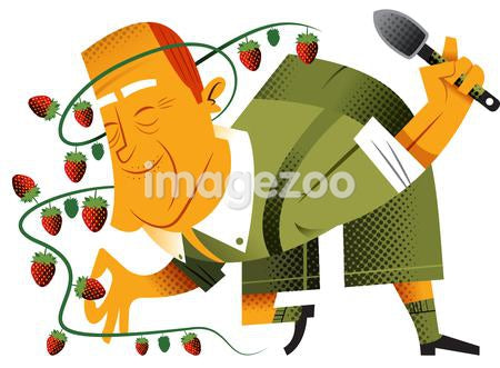 A man surrounded by strawberries
