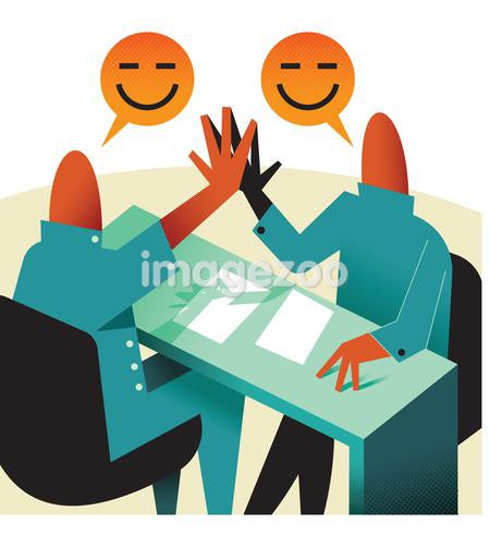 Two people high fiving at a desk