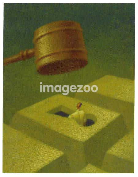 A businessman being hit by giant gavel