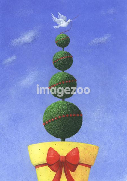 Christmas topiary with a dove perched on top