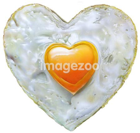 Heart shaped fried egg against white background