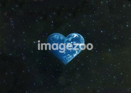 Heart shaped earth in sky