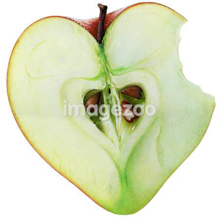Heart shaped halved apple with missing bite