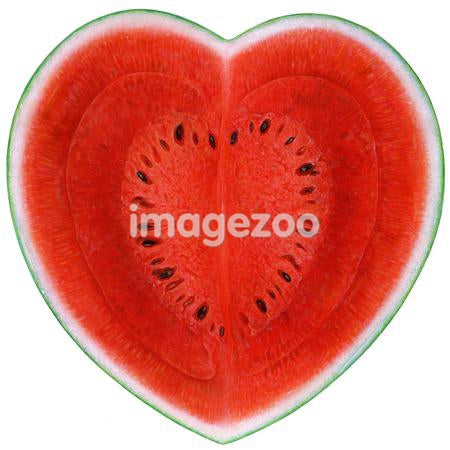 Heart shaped watermelon against white background