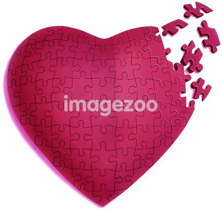 Heart shaped puzzle against white background