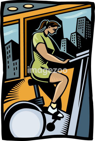 A woman exercising on an exercise bike