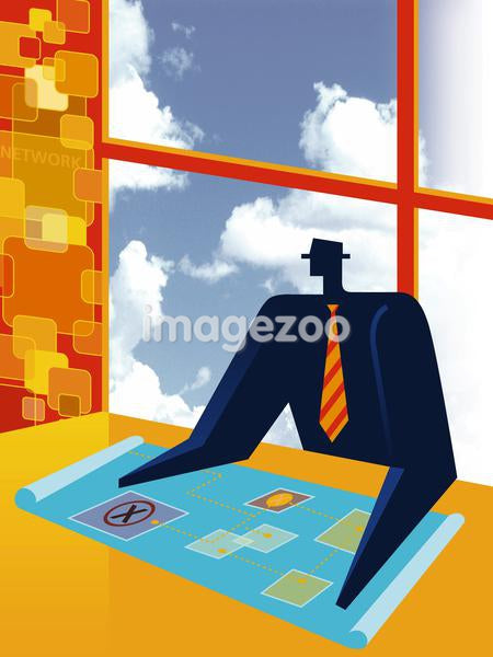 A businessman looking at blueprints