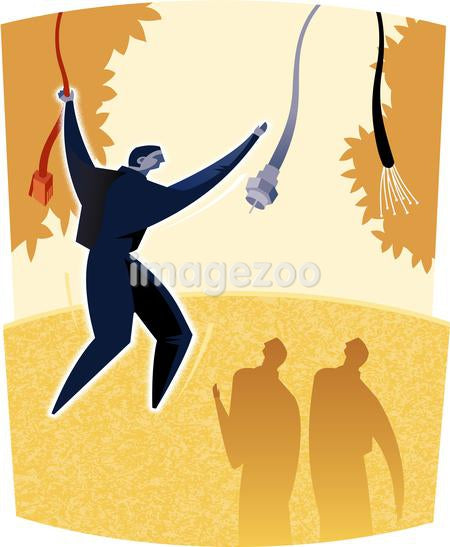 A man swinging from cord to cord