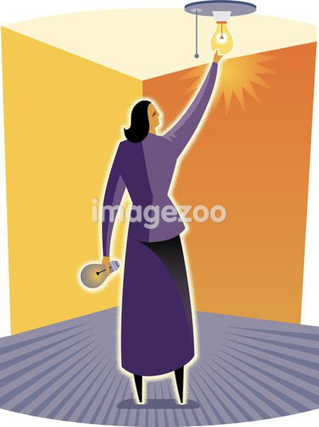 A woman changing a light bulb