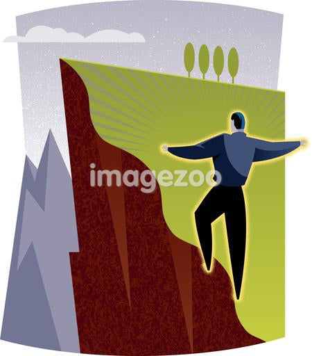 A man on the edge of a steep hill
