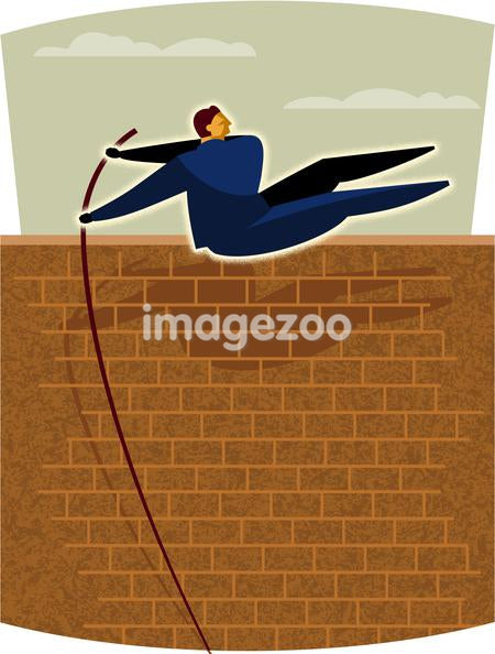 A businessman doing the pole vault